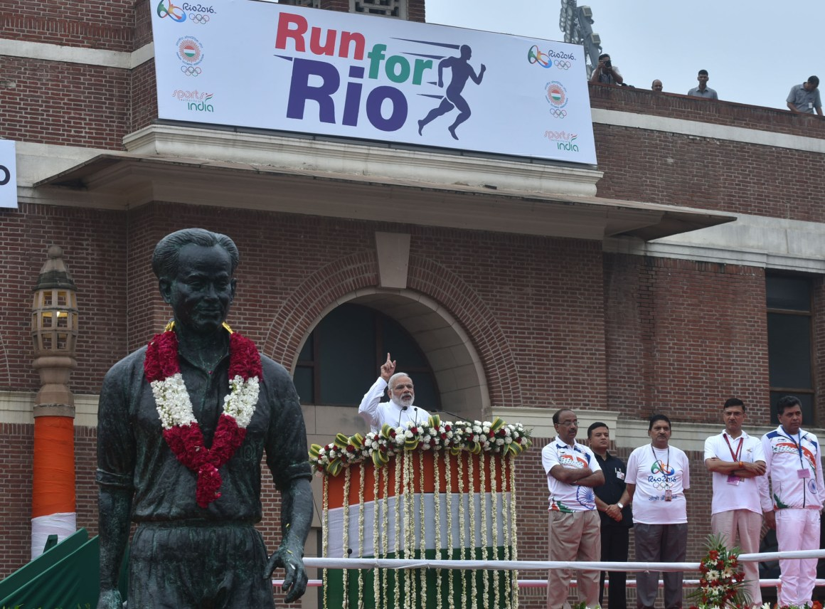 "The Prime Minister, Shri Narendra Modi addressing at the flagging off ceremony of ""Run For Rio"", at Major Dhyan Chand National Stadium, in New Delhi on July 31, 2016. The Minister of State for Youth Affairs and Sports (I/C), Water Resources, River Development and Ganga Rejuvenation, Shri Vijay Goel and the Secretary, Ministry of Youth & Sports, Shri Rajiv Yadav are also seen."