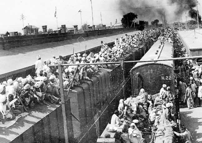 MILLENNIUM PHOTO: FREEDOM MOVEMENT, HISTORY'S BIGGEST MIGRATION. TRAIN LOADED TO CAPACITY, INDIA PAKISTAN PARTITION.. ISSUED BY DIRECTORATE OF PUBLIC RELATIONS, EAST PUNJAB.