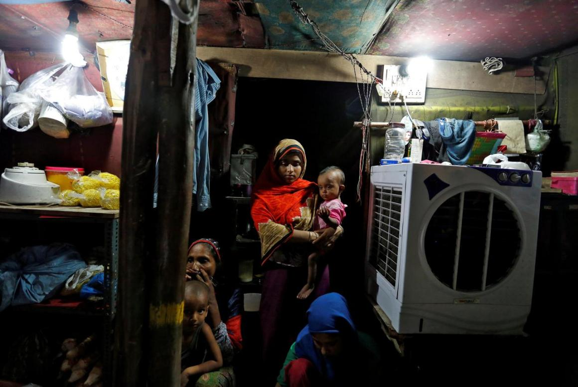 FILE PHOTO: A family from the Rohingya community is pictured inside their shack at a camp in Delhi, India August 17, 2017. REUTERS/Cathal McNaughton/File photo