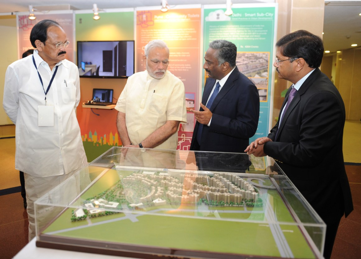 The Prime Minister, Shri Narendra Modi being briefed about the Smart Cities Mission, Atal Mission for Rejuvenation and Urban Transformation (AMRUT) and Housing for All Mission, in New Delhi on June 25, 2015. The Union Minister for Urban Development, Housing and Urban Poverty Alleviation and Parliamentary Affairs, Shri M. Venkaiah Naidu is also seen.