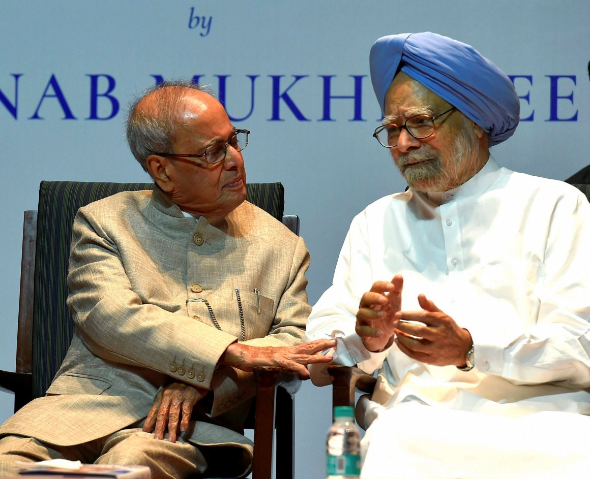 "New Delhi: Former President Pranab Mukherjee with former prime minister Manmohan Singh at the release of his book ""The Coalition Years"" at a function in New Delhi on Friday. PTI Photo by Atul Yadav (PTI10_13_2017_000129B)"