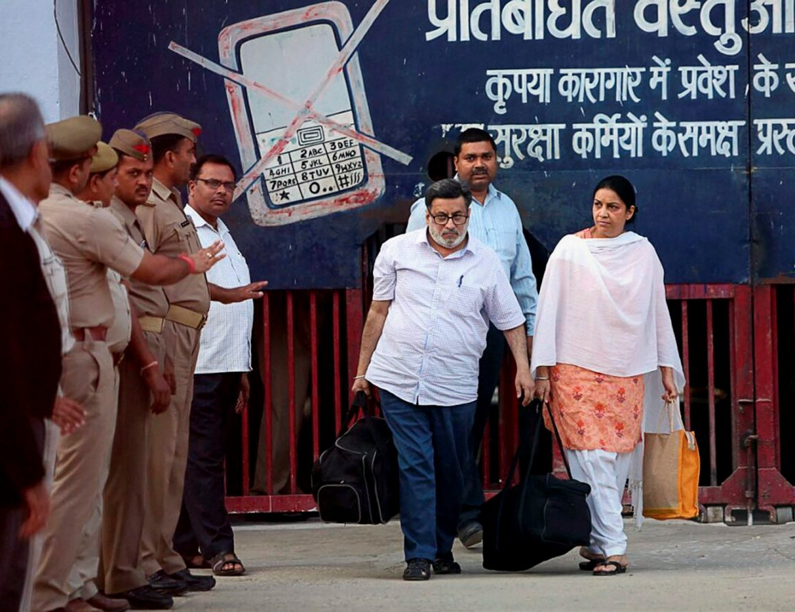 Ghaziabad: Dentist-couple Nupur and Rajesh Talwar coming out of the Dasna Jail in Ghaziabad on Monday after they were released following their acquittal in the twin murder case of their daughter Aarushi and domestic help Hemraj. PTI Photo    (PTI10_16_2017_000116B)