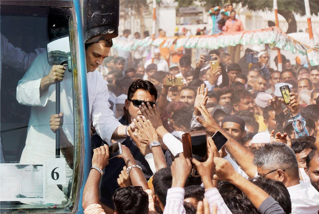 Bharuch: Congress vice-president Rahul Gandhi meeting supporters during a road show at Samni village of Bharuch district on Wednesday. PTI Photo