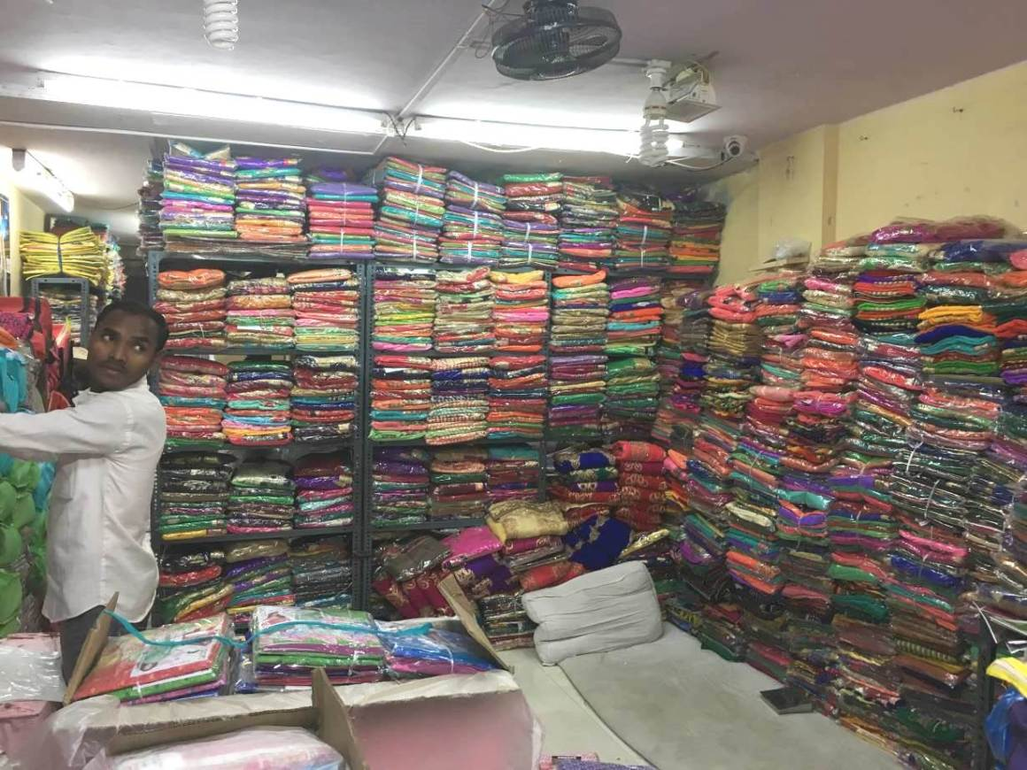 A shop stacked with saris in the textile market in the port city of Surat, which produces the highest volume of synthetic fabric in India. THOMSON REUTERS FOUNDATION/Roli Srivastava