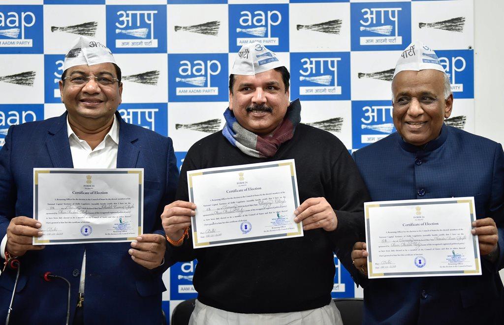 New Delhi: Newly-elected Delhi Rajya Sabha MPs Sushil Gupta, Sanjay Singh and ND Gupta pose with their certificates, in New Delhi on Monday. PTI Photo by Ravi Choudhary (PTI1 8 2018 000141B)
