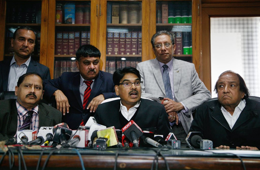 New Delhi: Bar Council of India Chairman Manan Kumar Mishra with other members addresses a press conference in New Delhi on Monday. PTI Photo (PTI1_15_2018_000129B)