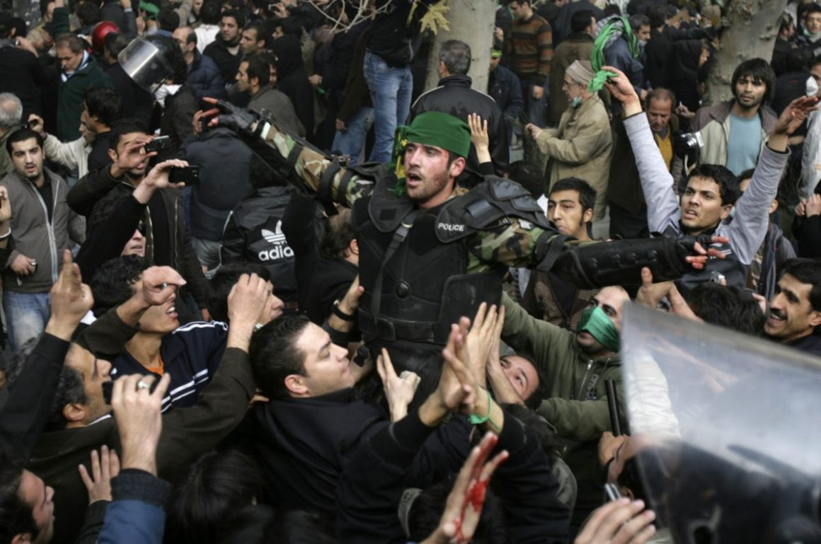 In this photo taken by a person not employed by the Associated Press and obtained by the AP outside Iran, university students attended a protest inside Tehran University on Saturday, with anti-riot Iranian police officers preventing them from joining other protesters. Reuters