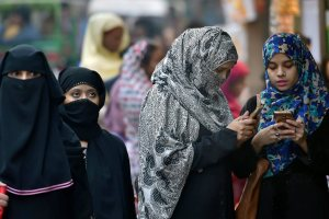 New Delhi: A group of muslim women at a market in the walled city area of Delhi on Thursday. The Muslim Women (Protection of Rights of Marriage) Bill, 2017, which makes instant triple talaq illegal and void, was introduced in Parliament. PTI Photo by Shahbaz Khan (PTI12_28_2017_000128B)