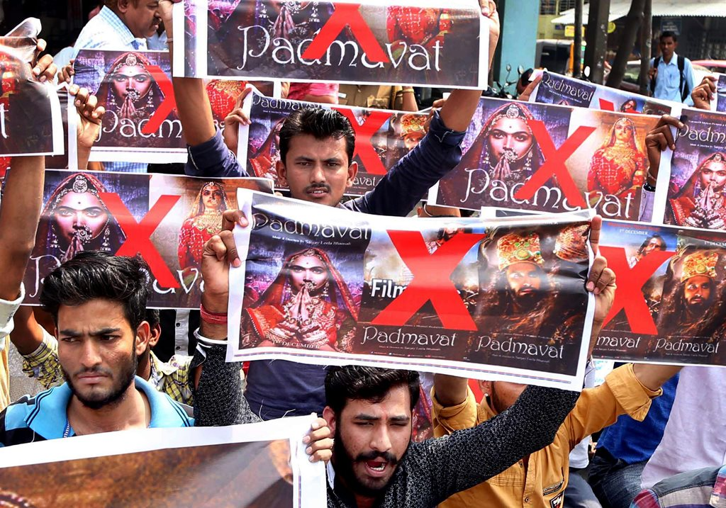"Coimbatore: Activists of Rashtriya Rajput Karni Sena holding banners and raising slogans during a protest against the release of the film ""Padmaavat"" in Coimbatore on Thursday. PTI Photo (PTI1_25_2018_000088B)"