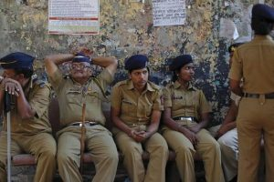 Policemen keep watch during a protest rally organised by various trade unions in Mumbai, February 28, 2012. REUTERS/Danish Siddiqui
