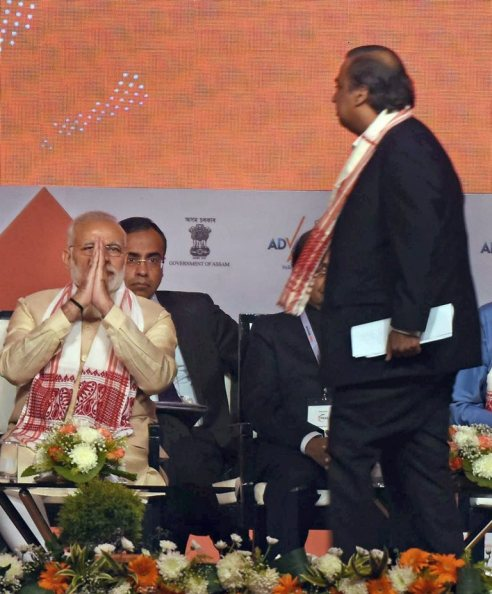 Guwahati: Prime Minister Narendra Modi and industrialist Mukesh Ambani at the Advantage Assam- Global Investors Summit 2018, in Guwahati on Saturday. PTI Photo (PTI2_3_2018_000110B)