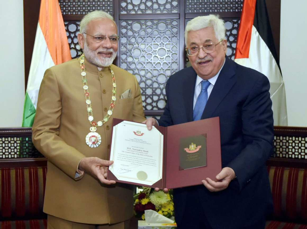 Ramallah: Prime Minister Narendra Modi receives the Grand Collar-(the highest order given to foreign dignitaries) by Palestinian President Mahmoud Abbas after the conclusion of their bilateral meeting in Ramallah on Saturday. PM Modi received the Grand Collar for his contribution to relations between India and Palestine. PTI photo /PIB (PTI2_10_2018_000113B)