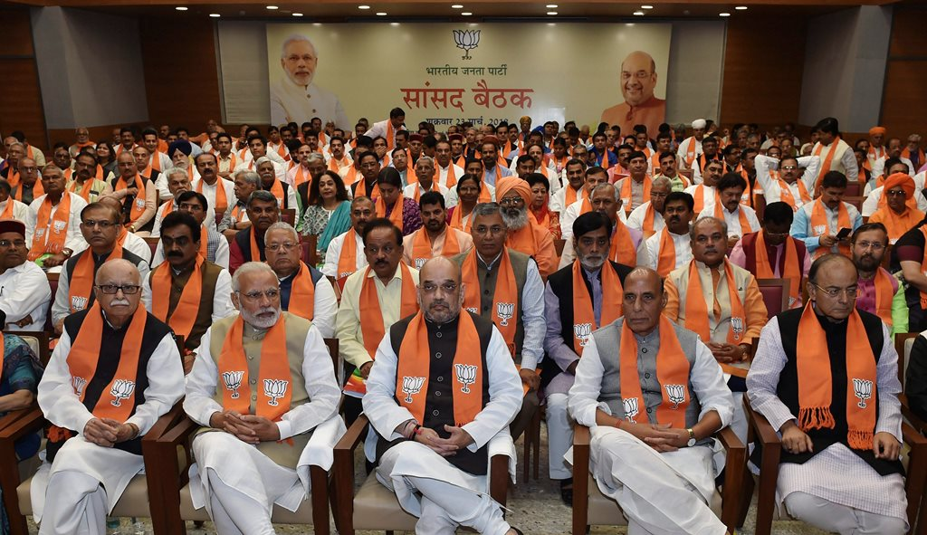 New Delhi: Prime Minister Narendra Modi with BJP leaders Amit Shah, Rajnath Singh, Lal Krishna Advani, Arun Jaitley and others during BJP Parliamentary meeting at the party headquarters in New Delhi on Friday. PTI Photo By Manvender Vashist(PTI3_23_2018_000195B)