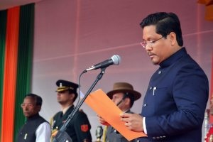 Shillong: National People's Party (NPP) President Conrad K Sangma takes oath as Meghalaya Chief Minister during swearing-in ceremony as Meghalaya Governor Ganga Prasad looks on, in Shillong on Tuesday. PTI Photo (PTI3_6_2018_000046B)
