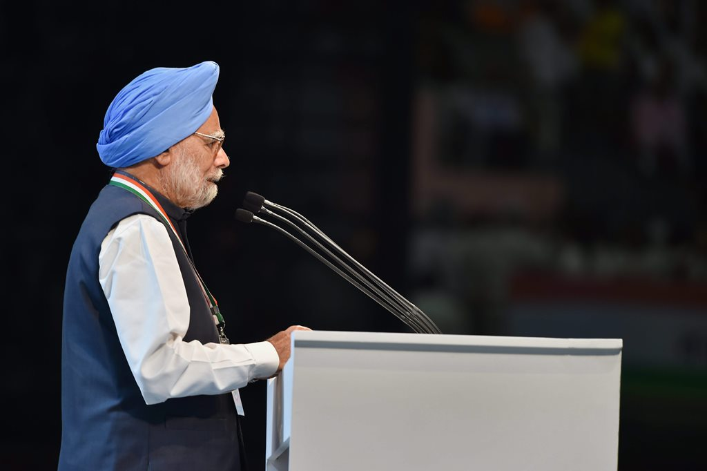 New Delhi: Former Prime Minister Manmohan Singh speaks during the second day of the 84th Plenary Session of Indian National Congress (INC), at the Indira Gandhi stadium in New Delhi on Sunday. PTI Photo by Vijay Verma (PTI3_18_2018_000081B)