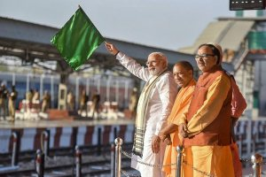 Varanasi : Prime Minister Narendra Modi flagging off the train between Maduadih and Patna, at Maduadih, in Varanasi, Uttar Pradesh on Monday. The Chief Minister of Uttar Pradesh, Yogi Adityanath is also seen.PTI Photo/PIB (PTI3_12_2018_000192B)