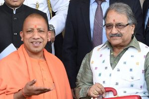 Lucknow: Uttar Pradesh Chief Minister Yogi Adityanath and UP Finance Minister Rajesh Agarwal hold a briefcase containing State Budget for 2018-19 ahead of presentation, at Vidhan Sabha in Lucknow on Friday. PTI Photo by Nand Kumar(PTI2_16_2018_000135B)