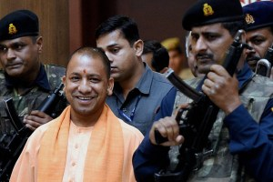 Lucknow: UP Chief Minister Yogi Adityanath coming out after the cabinet meeting at Lok Bhawan in Lucknow on Tuesday.  PTI Photo by Nand Kumar (PTI4_4_2017_000182B)