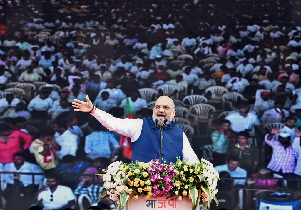 Mumbai: BJP President Amit Shah gestures as he speaks during BJP's 38th Foundation Day celebrations in Mumbai on Friday. PTI Photo by Mitesh Bhuvad (PTI4_6_2018_000149B)