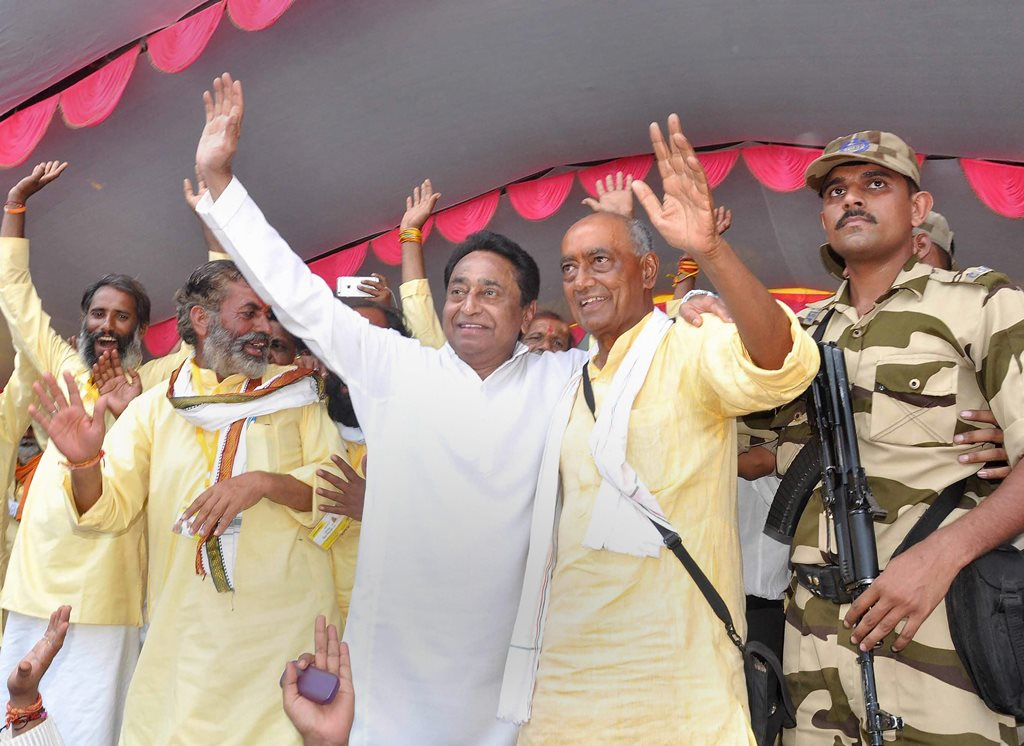 Narsinghpur: Congress leaders Digvijaya Singh and Kamal Nath wave at their party supporters after completion of Singh's six-month-long 'Narmada Parikrama', in Narsinghpur on Monday. PTI Photo (PTI4_9_2018_000176B)