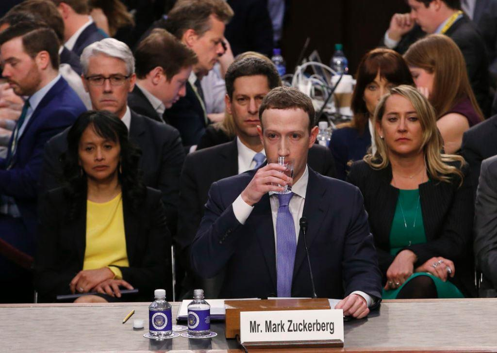 Facebook CEO Mark Zuckerberg takes a drink while testifying before a Senate Judiciary and Commerce Committees joint hearing regarding the company?s use and protection of user data on Capitol Hill in Washington, U.S., April 10, 2018. REUTERS/Alex Brandon/Pool
