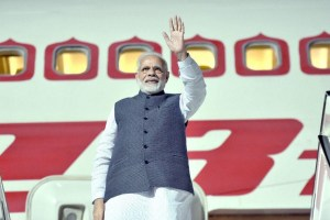New Delhi: Prime Minister Narendra Modi waves as leaves for Delhi from Berlin after a three-nation tour, in New Delhi on Saturday. PTI Photo PTI Photo / PIB(PTI4_21_2018_000024B)