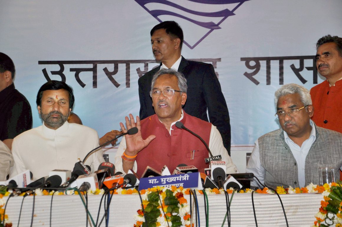 Dehradun: Uttarakhand chief minister Trivendra Singh Rawat, along with minister Prakash Pant and Madan Kaushik, addresses a press conference in Dehradun on Monday. PTI Photo (PTI3_20_2017_000144B)