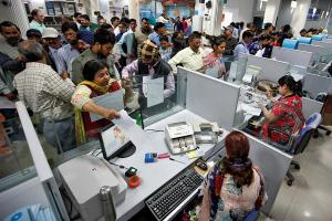People stand in queues at cash counters to deposit and withdraw money inside a bank in Chandigarh, India, November 10, 2016. Ajay Verma/ REUTERS