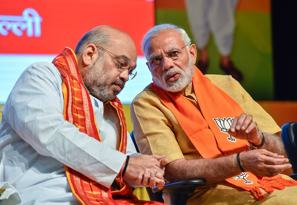 New Delhi: Prime Minister Narendra Modi and BJP National President Amit Shah at the concluding session of the National Executive Committee meeting of the party's all wings (morchas)' at Civic Centre in New Delhi, on Thursday. (PTI Photo/Kamal Singh) (PTI5_17_2018_000164B)