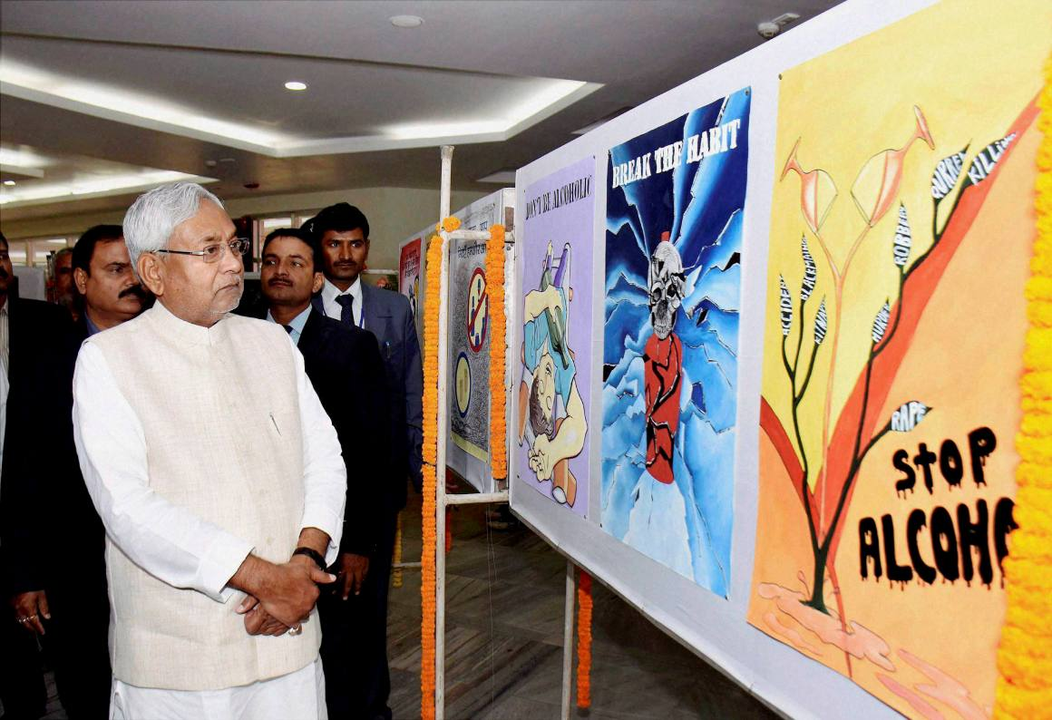 Patna:  Bihar chief minister Nitish Kumar looking poster during the  Non Alcohol Prohibition Day function in Patna on Thursday. PTI Photo(PTI11_26_2015_000211A)