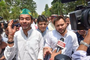 Patna: Bihar opposition leader Tejashwi Yadav with RJD leader Tej Pratap and Congress MLAs march towards Raj Bhawan for stake claim to form the government in the state, being the single largest party in the Legislative Assembly, in Patna on Friday. (PTI Photo)(PTI5_18_2018_000097B)