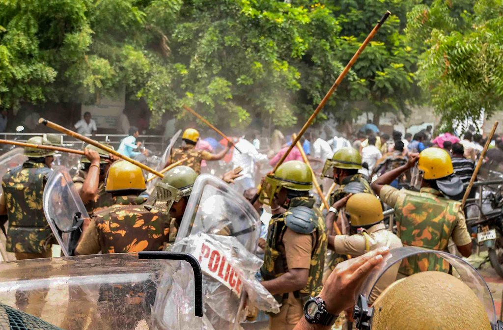 Tuticorin: Police personnel baton charge at protestors who were demanding the closure of Vedanta's Sterlite Copper unit, in Tuticorin, on Wednesday. In fresh violence today, one person was killed during the clash, after police's open fire killing at least ten people yesterday, and injuring many others. (PTI Photo) (PTI5_23_2018_000194B)