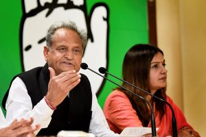 New Delhi: Senior Congress leader Ashok Gehlot addresses a press conference, in New Delhi, on Wednesday. AICC spokespersons Randeep Singh Surjewala and Priyanka Chaturvedi are also seen. (PTI Photo/Kamal Singh)(PTI5_23_2018_000053B)