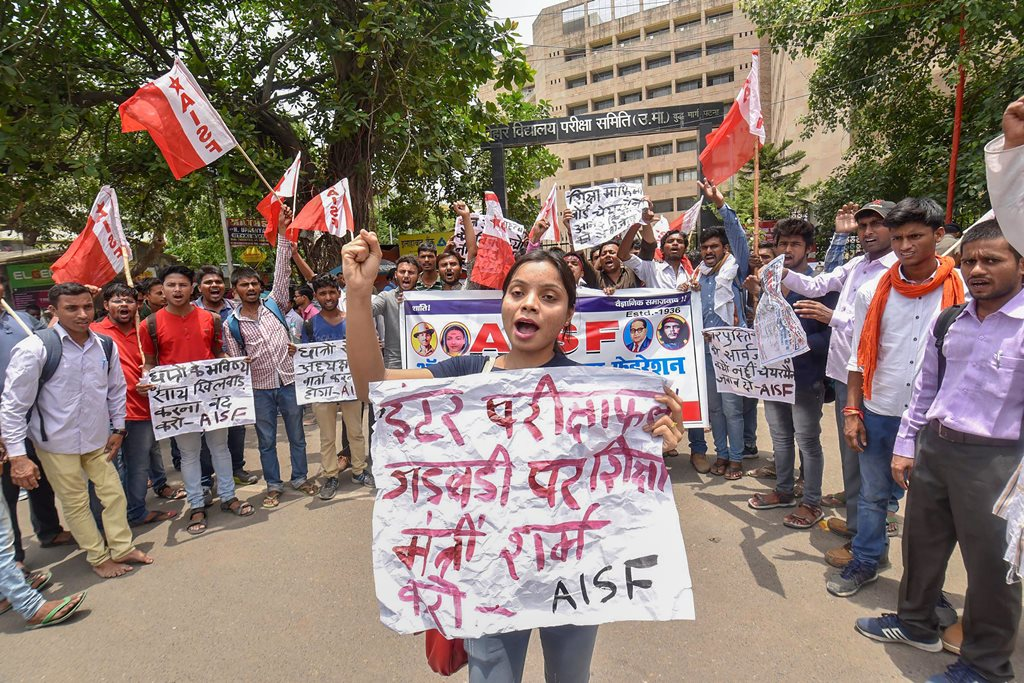 Patna: All India Students Federation activists raise slogans during a protest against the low pass percentage in the Intermediate exams, in Patna on Wednesday, June 13, 2018. (PTI Photo) (PTI6_13_2018_000049B)