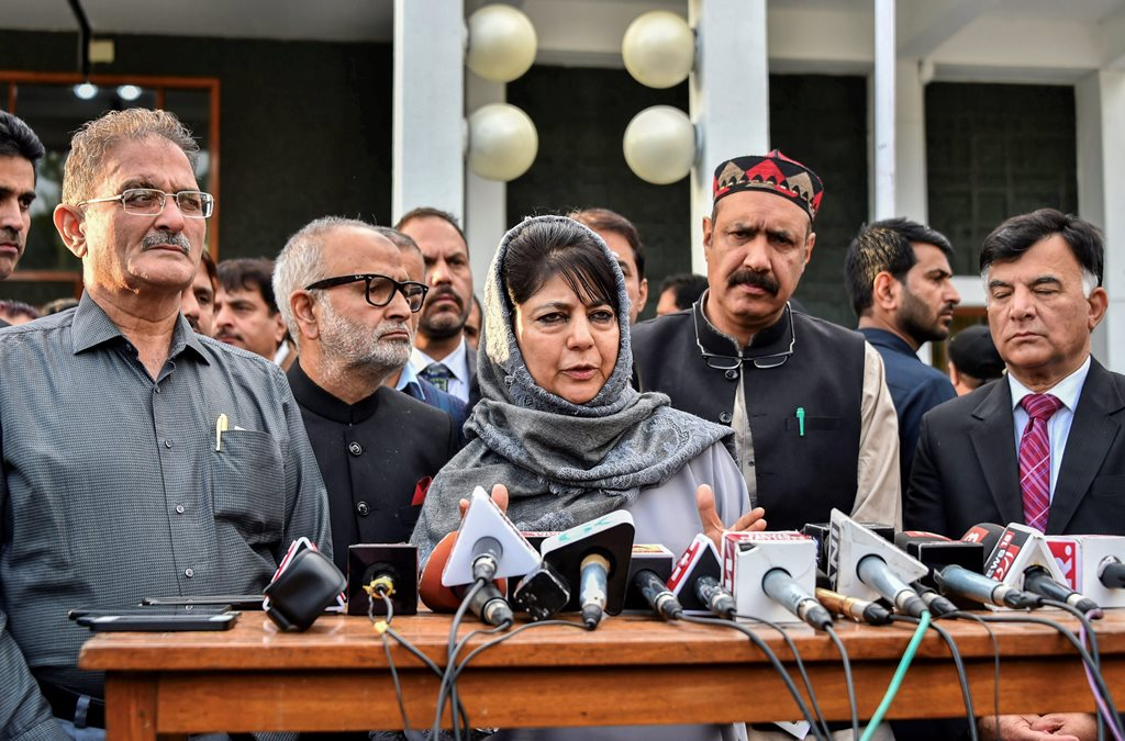 **FILE PHOTO** Srinagar: In this file photo dated May 09, 2018, Jammu and Kashmir Chief Minister Mehbooba Mufti addresses the media as Deputy Chief Minister Kavinder Gupta (L) looks on after an all-party meeting at SKICC in Srinagar. BJP on Tuesday, June 19, 2018, has pulled out of the PDP-BJP alliance government in Jammu and Kashmir. (PTI Photo/S Irfan)(PTI6_19_2018_000081B)