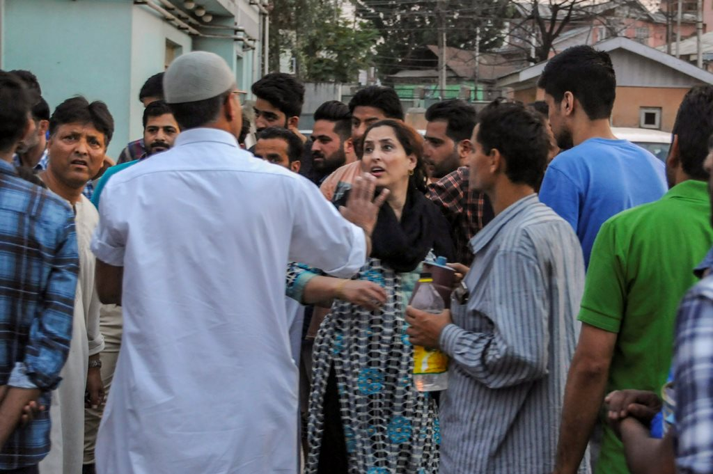 Srinagar: Relatives and friends of senior journalist Shujaat Bukhari react at a hospital after he was killed along with his PSO's by suspected militants, in Srinagar on Thursday, June 14, 2018. (PTI Photo) (PTI6_14_2018_000221B)