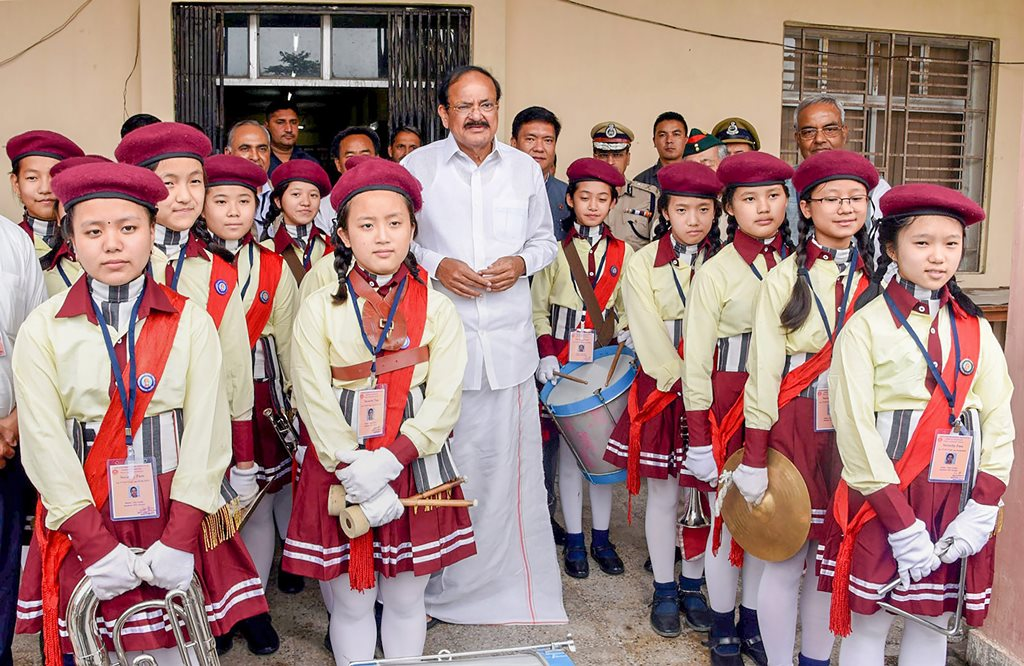 Itanagar: Vice President M Venkaiah Naidu with band members of a band who played National Anthem at the North Eastern Regional Institute of Science and Technology (NERIST), in Itanagar on Sunday, June 17, 2018. (PTI Photo) (PTI6_17_2018_000046B)