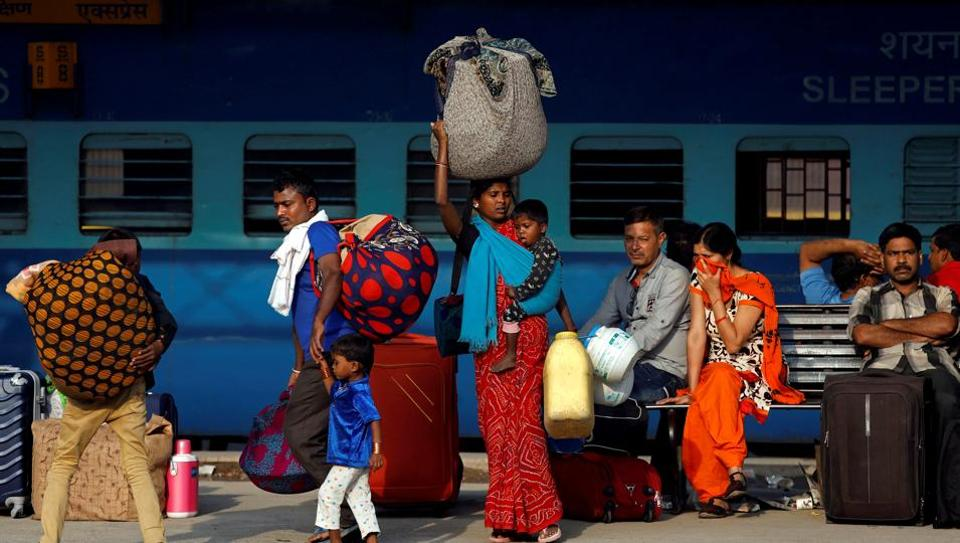 passengers railway-platform-carrying-luggage Reuters