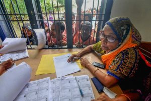 Morigaon: People wait in a queue to check their names on the final draft of the state's National Register of Citizens after it was released, at an NRC Seva Kendra, in Morigaon on Monday, July 30, 2018. (PTI Photo) (PTI7_31_2018_000037B)