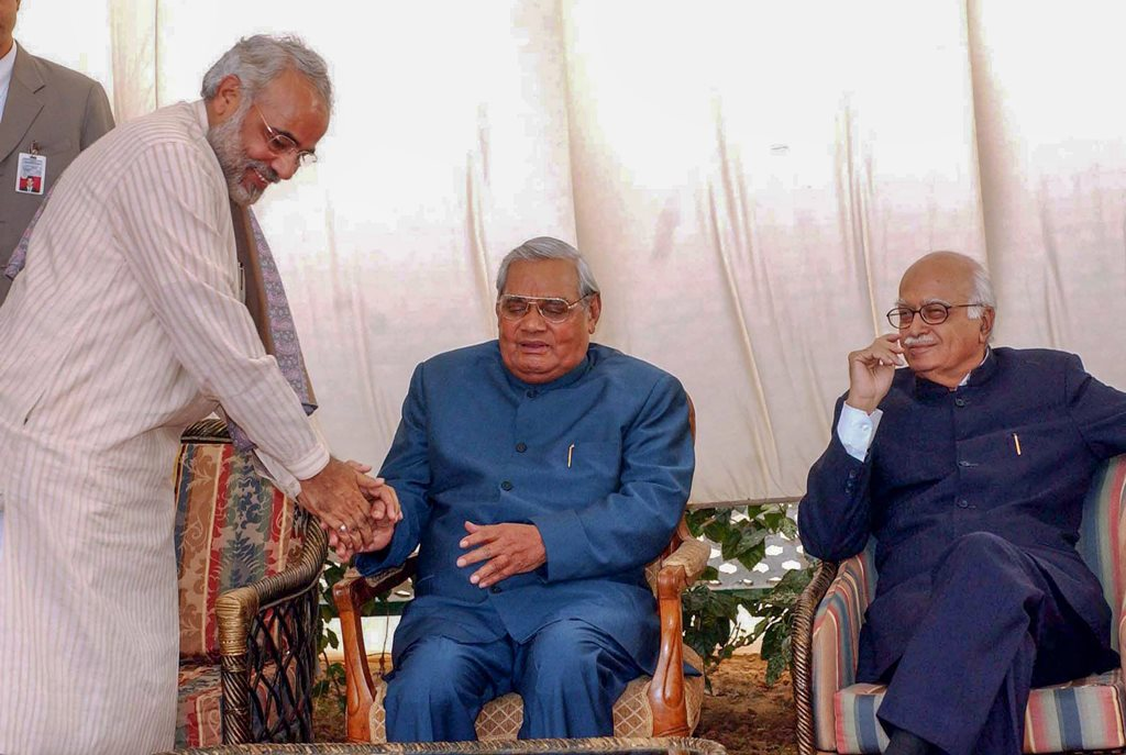 **FILE** New Delhi: In this Dec 09, 2003, file photo former prime minister Atal Bihari Vajpayee is seen with the then Gujarat CM Narendra Modi and BJP senior leader LK Advani at a lunch in New Delhi. Vajpayee, 93, passed away on Thursday, Aug 16, 2018, at the All India Institute of Medical Sciences, New Delhi after a prolonged illness. (PTI Photo) (PTI8_16_2018_000160B)