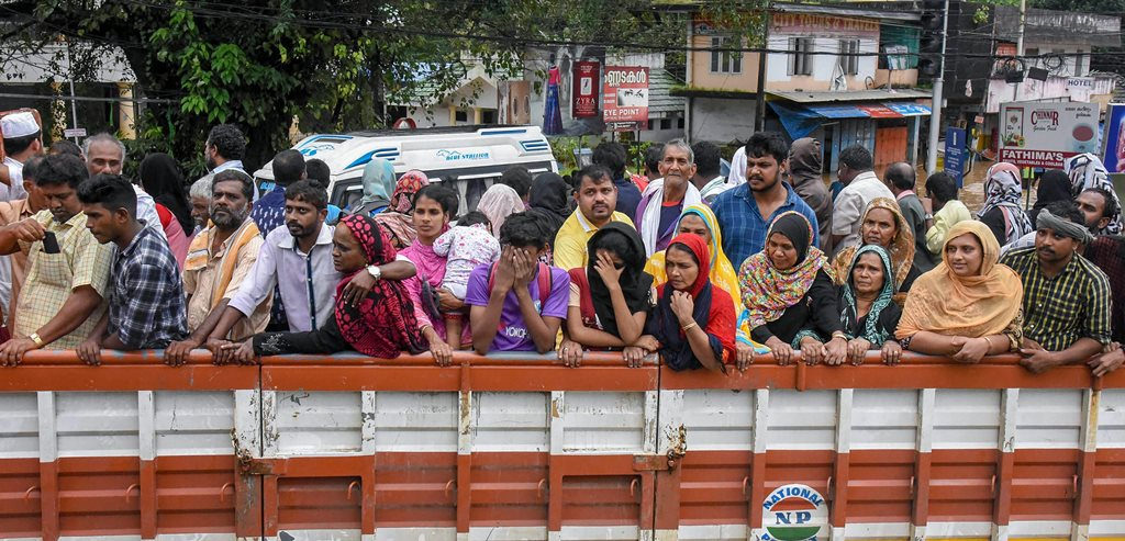 Kochi: People being rescued from flood-affected regions and taken to shelter camps in trucks following heavy monsoon rainfall, in Kochi on Saturday, Aug 18, 2018. (PTI Photo) (PTI8_18_2018_000109B)