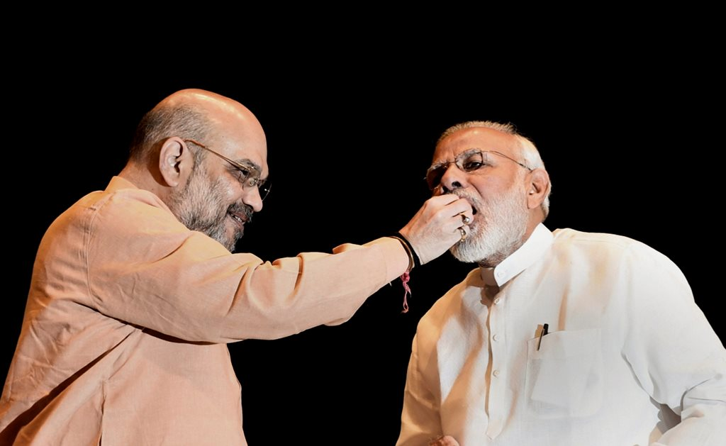 New Delhi: Prime Minister Narendra Modi being offered sweets by BJP President Amit Shah during BJP Parliamentary Party meeting, in New Delhi on Tuesday, July 31, 2018. (PTI Photo/Atul Yadav) (PTI7_31_2018_000030B)