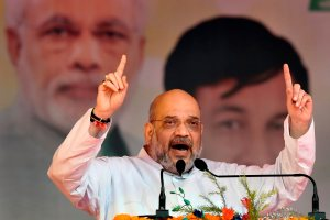New Delhi: BJP President Amit Shah addresses during the Purvanchal Mahakumbh, at Ramleela Maidan in New Delhi, Sunday, Sept 23, 2018. (PTI Photo/Ravi Choudhary) (PTI9_23_2018_000086B)