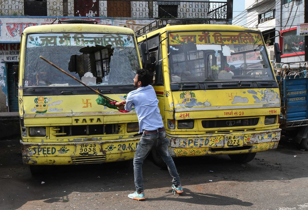 Patna: Jan Adhikar Party supporter vandalises vehicles during 'Bharat Bandh' protest against fuel price hike and depreciation of the rupee, in Patna, Monday, Sept 10, 2018. (PTI Photo)(PTI9_10_2018_000026B)