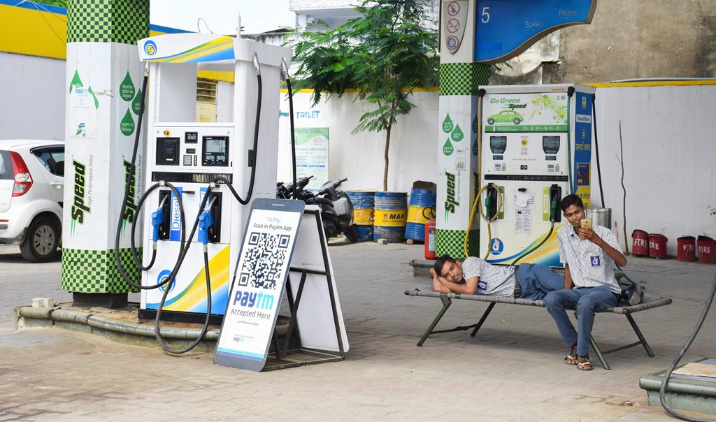 Beawar: Petrol pump attendants sit idle during the Bharat Bandh, called by the upper-caste organisations in protest over the recent amendment of the SC/ST Act, in Beawar, Thursday, Sept 6, 2018. (PTI Photo) (PTI9_6_2018_000093B)