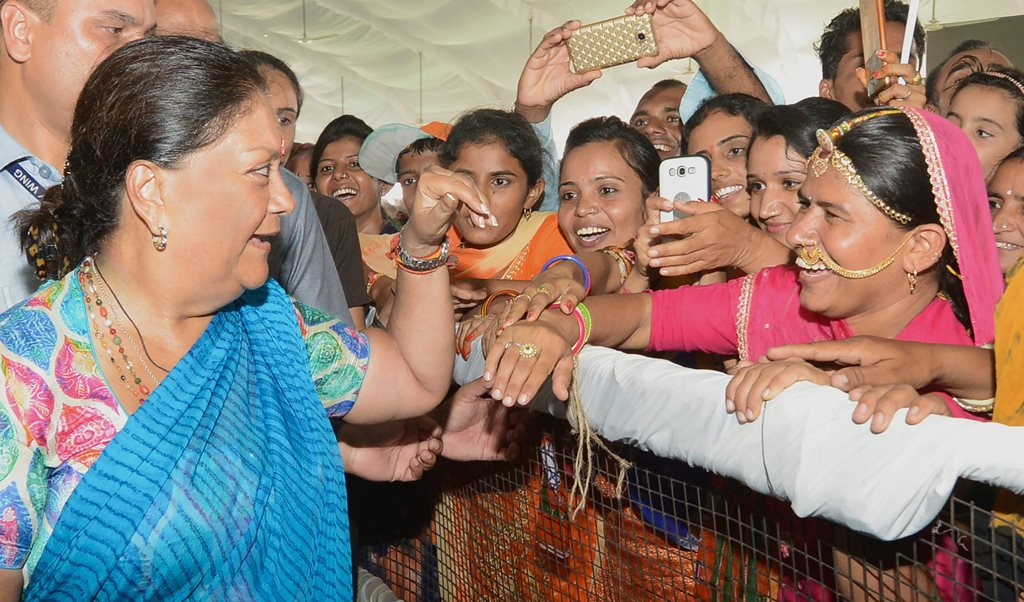 Barmer: Rajasthan Chief Minister Vasundhara Raje interacts with women in a public rally during her 'Rajasthan Gaurav Yatra' at Gudamalani, near Barmer on Saturday, Sept 1, 2018. (PTI Photo) (PTI9_1_2018_000109B)