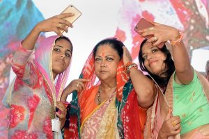Barmer: Women take selfie with Rajasthan Chief Minister Vasundhara Raje during 'Rajasthan Gaurav Yatra' at Baytu, near Barmer on Sunday, Sept 2, 2018. (PTI Photo) (PTI9_2_2018_000122B)