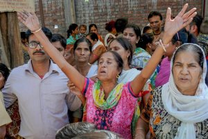 Amritsar: Relatives of victims of train accident mourn at Mass funeral in Amritsar, Saturday, Oct 20, 2018. Officials said at least 60 bodies have been found and many more injured have been admitted to a government hospital after the accident near the site of Dussehra festivities. (PTI Photo) (PTI10_20_2018_000061)