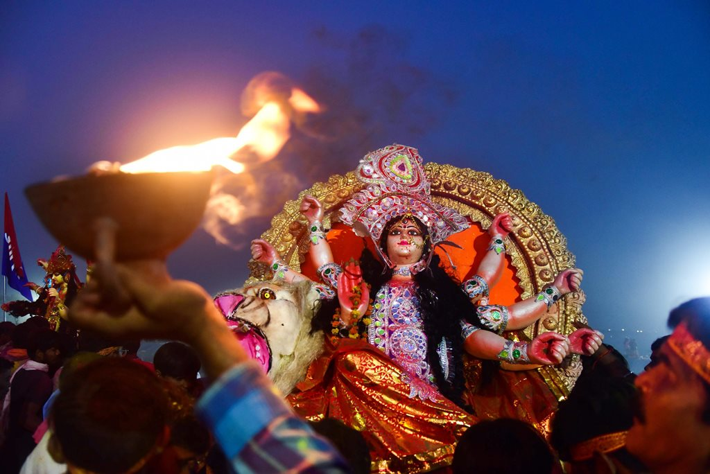 Allahabad: Hindu devotees carry an idol of Goddess Durga for immersion in a pond near Ganges River, at the end of Navratri festival in Allahabad, Friday, October 19, 2018. (PTI Photo) (PTI10_19_2018_000139B)