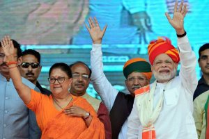 Ajmer: Prime Minister Narendra Modi and Rajasthan Chief Minister Vasundhara Raje greet their supporters during 'Vijay Sankalp Sabha', in Ajmer, Saturday, Oct 6, 2018. (PTI Photo) (PTI10_6_2018_000122B)